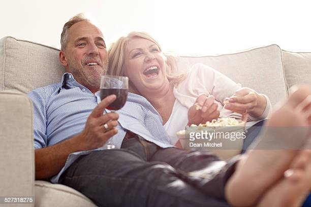 Mature couple enjoying watching movie