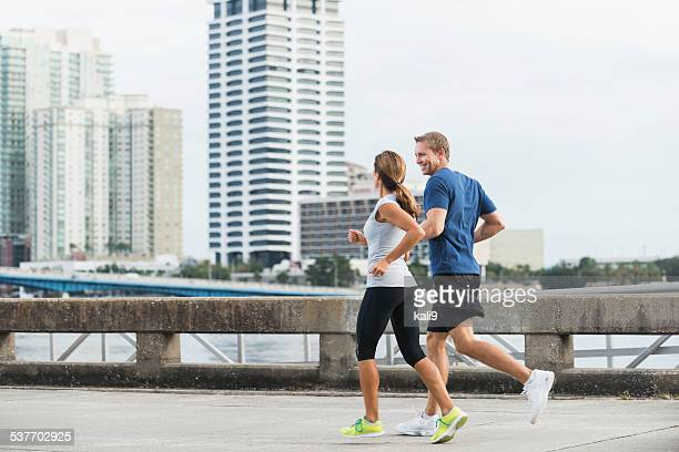 Mature couple exercising together on urban waterfront