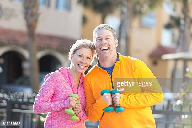 mature couple exercising together with hand weights - hand weight stock pictures, royalty-free photos & images