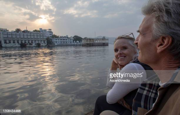 mature couple explores a ghat at sunrise - udaipur stock pictures, royalty-free photos & images
