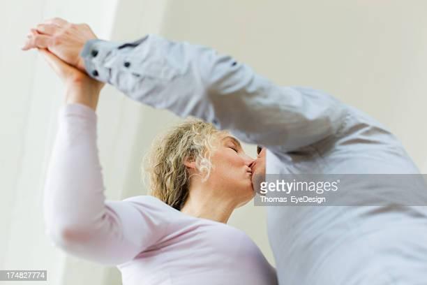 älteres paar falling in love - erotische umarmung stock-fotos und bilder