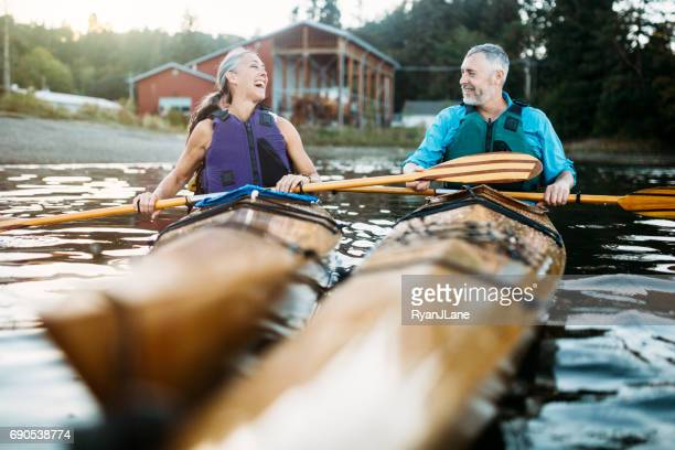 mature couple has fun kayaking - active senior woman stock photos and pictures