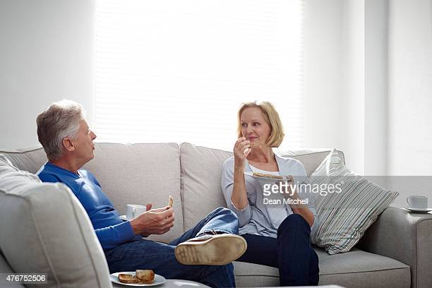 mature couple having a conversation - real wife sharing stock photos and pictures