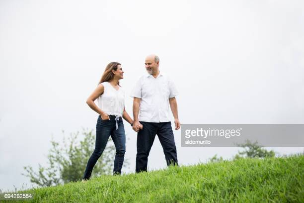 Mature couple having a walk hand by hand