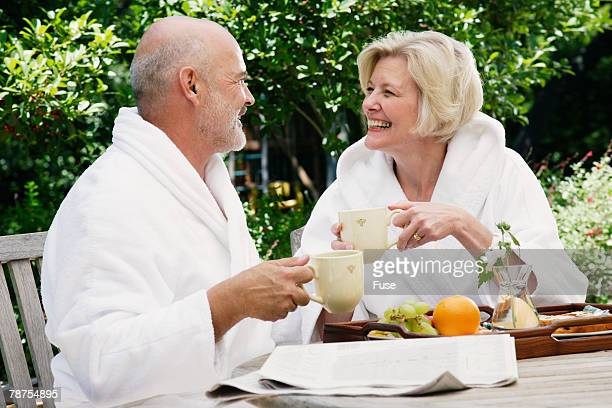 Mature Couple Having Breakfast at Resort