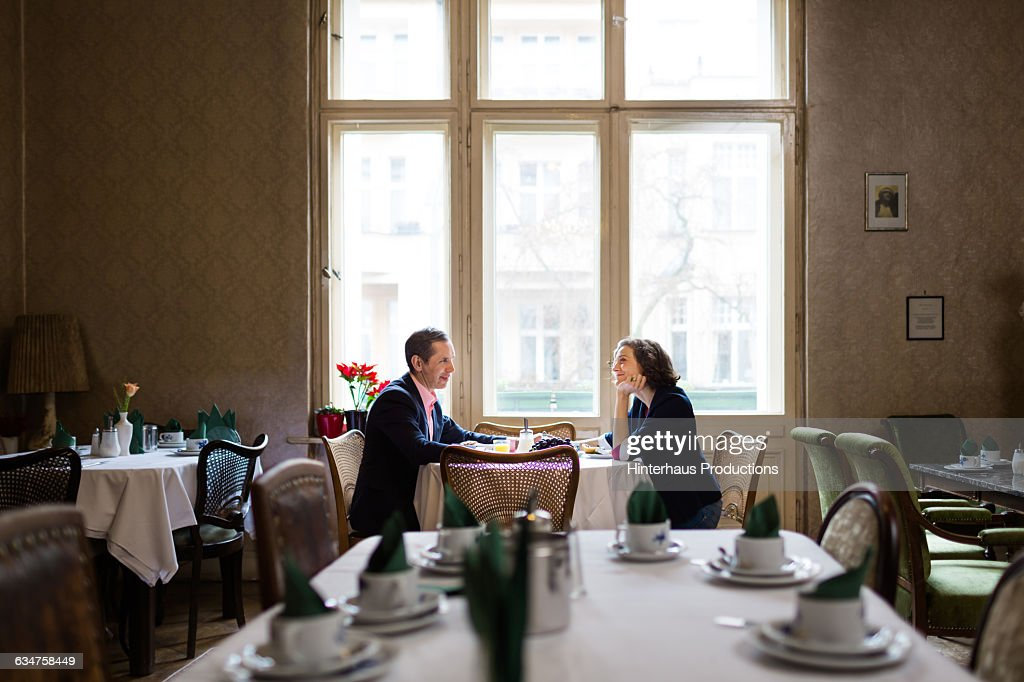 Mature couple having breakfast in an old hotel : Stock Photo