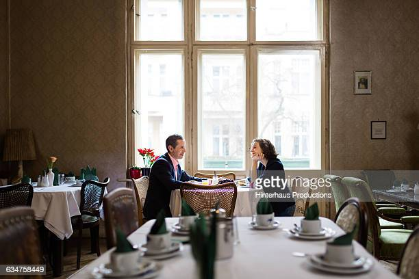 Mature couple having breakfast in an old hotel