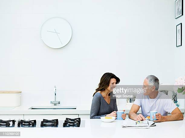 mature couple having breakfast - wall clock stock photos and pictures