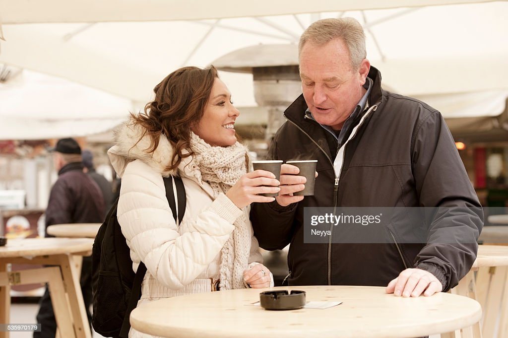 mature couple having coffee outdoors : Stock Photo