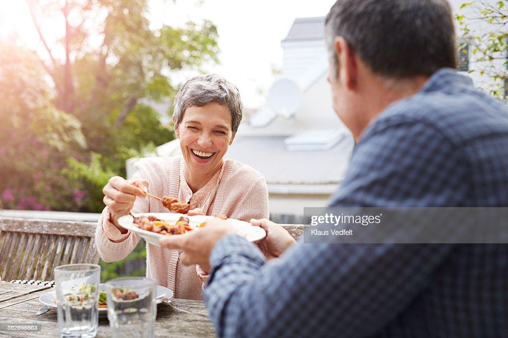 Mature couple having dinner outside : Stock Photo