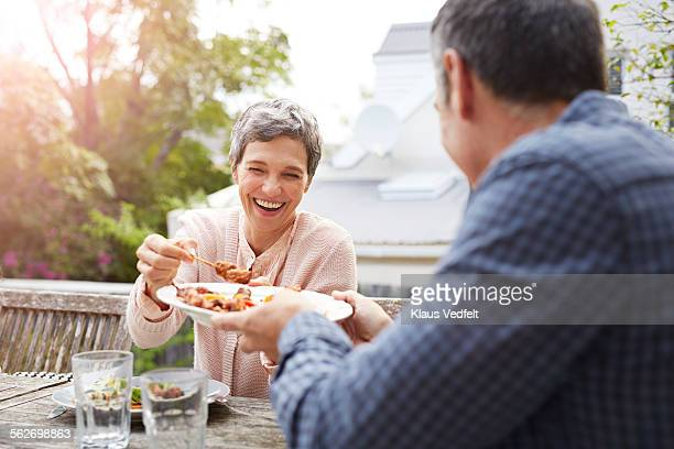 mature couple having dinner outside - man eating woman out - fotografias e filmes do acervo