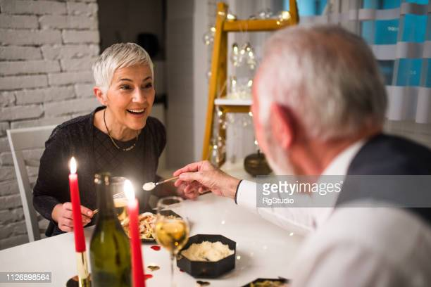 mature couple having dinner - valentines day dinner stock pictures, royalty-free photos & images