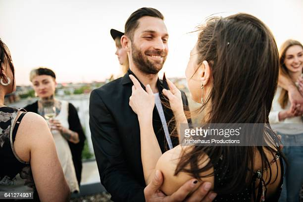 Mature couple having fun at party on rooftop