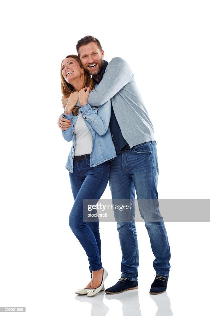 Casal se divertindo no fundo branco : Foto de stock