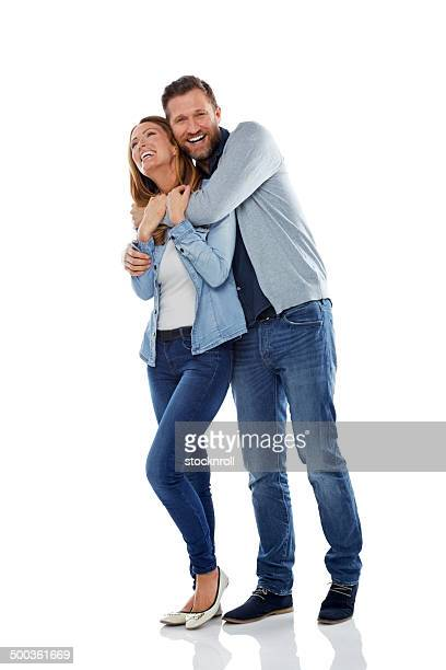 Mature couple having fun on white background
