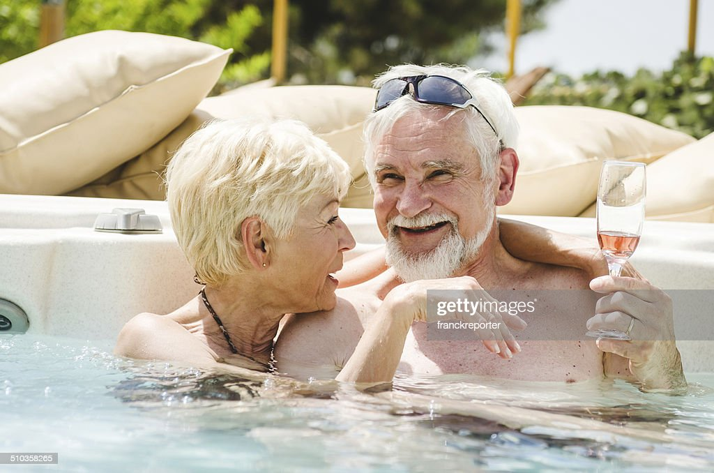 mature couple having fun togetherness in the pool : Stock Photo