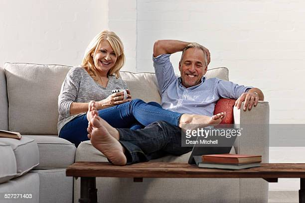 Mature couple having video conference on digital tablet