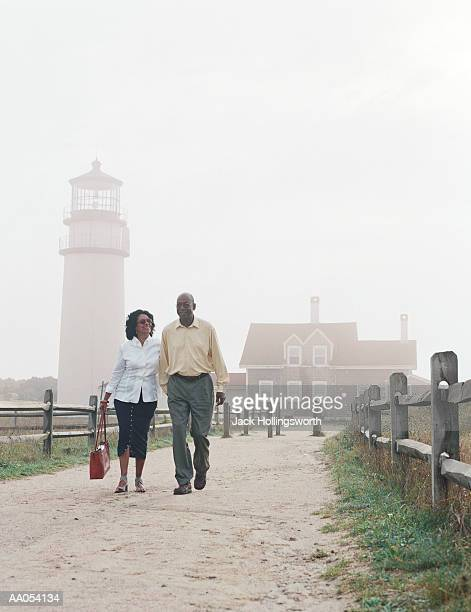 Mature couple holding hands, walking on beach, Cape Cod, USA