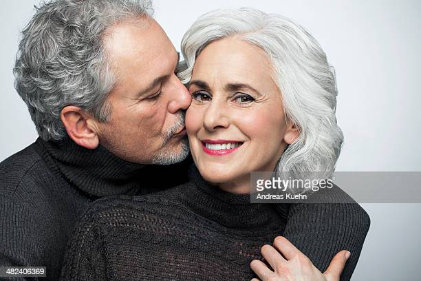 Mature couple hugging and kissing, portrait.