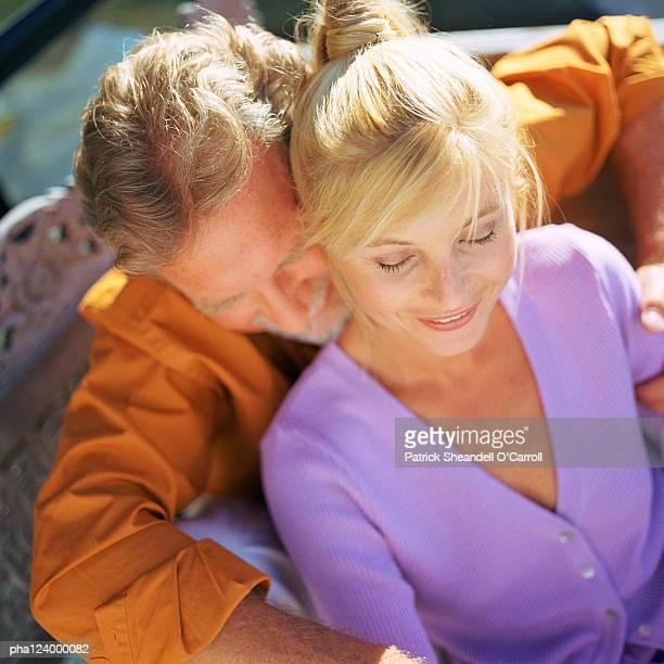 Mature couple hugging, high angle view