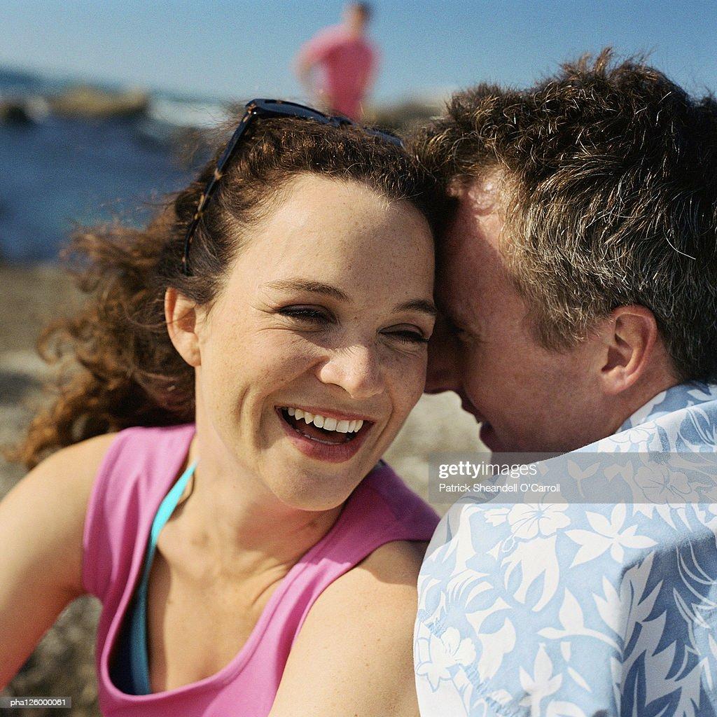 Mature couple hugging on beach, close-up : Stockfoto