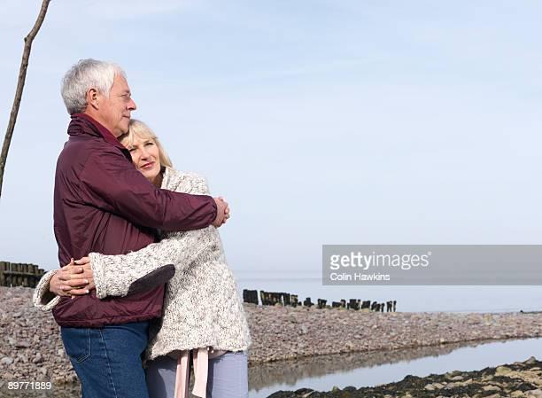 mature couple hugging on beach