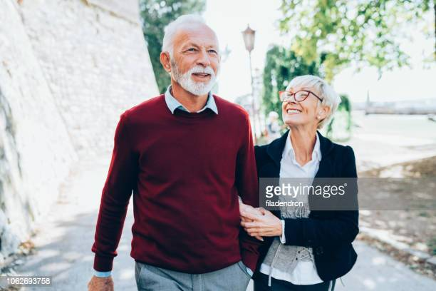 mature couple walking park