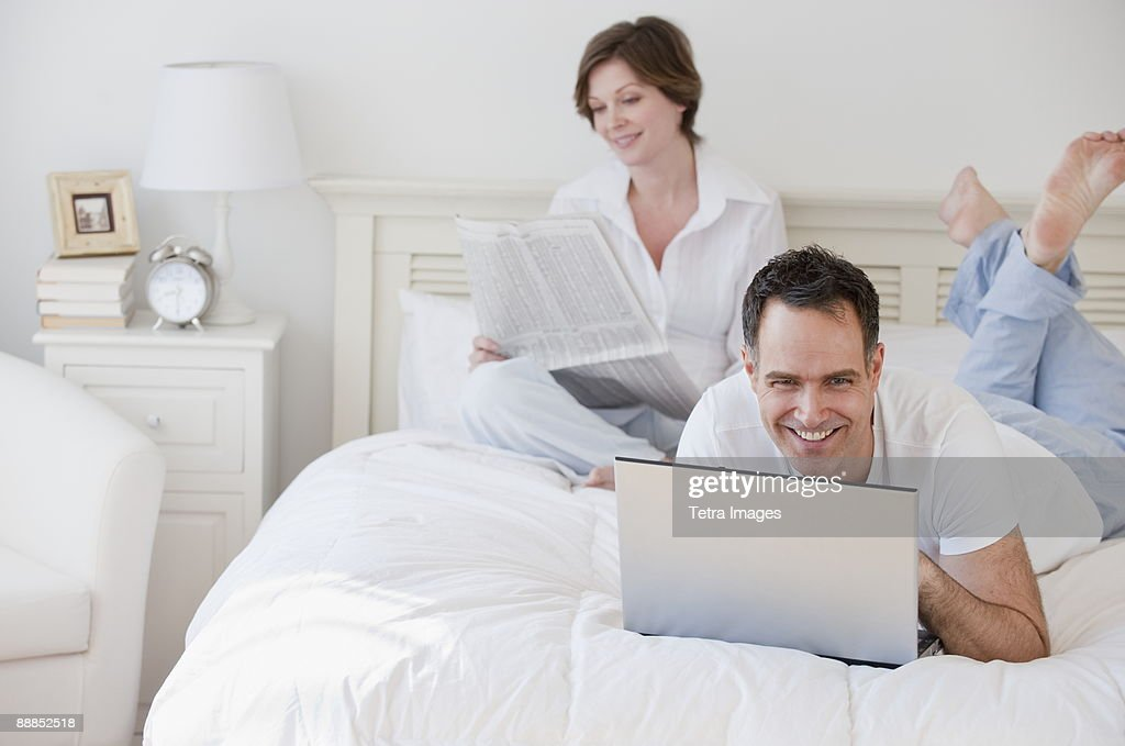 Mature couple in bed in the morning : Stock Photo