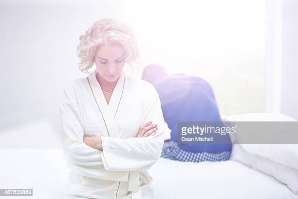 Mature couple in bedroom having an argument