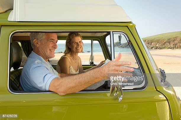 Mature couple in camper van