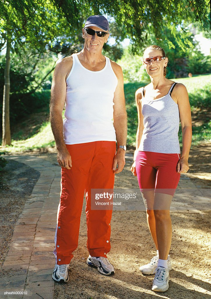 Mature couple in exercise clothes : Stockfoto