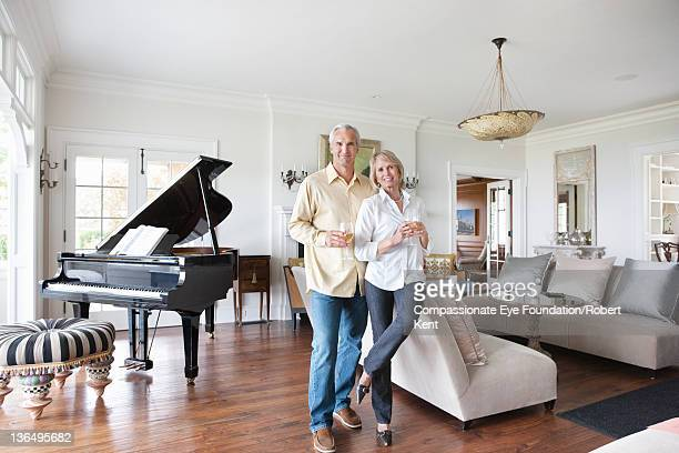 Mature couple in living room, portrait, smiling