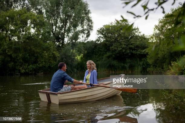 mature couple in rowing boat on rural lake - ウィルトシャー州 ストックフォトと画像