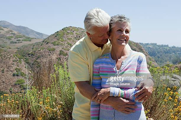Mature couple in rural setting