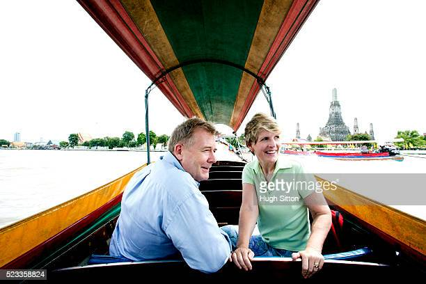 mature couple in tourboat sightseeing, bangkok, thailand - tourboat stock pictures, royalty-free photos & images
