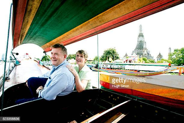 mature couple in tourboat sightseeing, bangkok, thailand - hugh sitton stock pictures, royalty-free photos & images