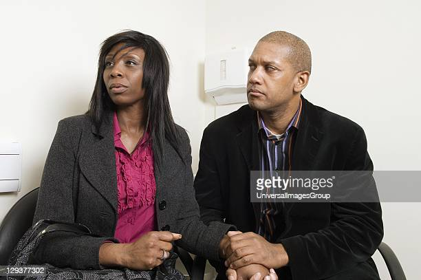 Mature couple in waiting room Before treatment begins prospective patients have a consultation to discuss treatment and the procedures involved in IVF