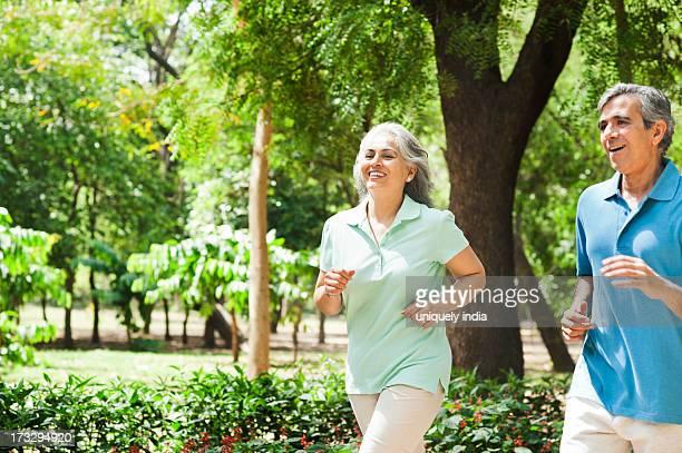 Mature couple jogging in a park, Lodi Gardens, New Delhi, India