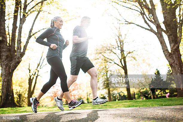 Mature Couple Jogging Outdoors