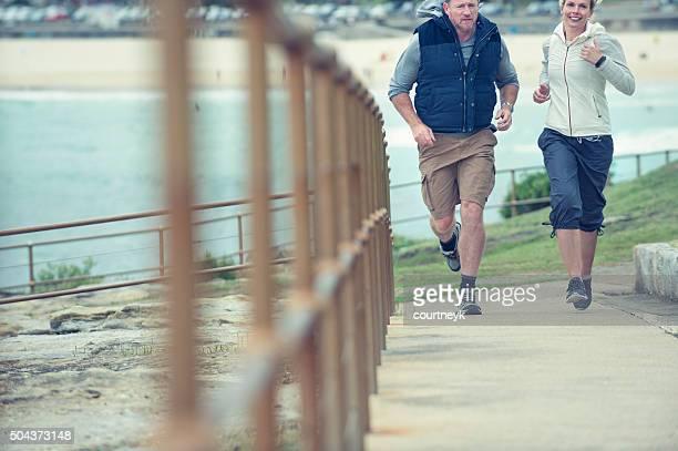 Mature couple jogging together.