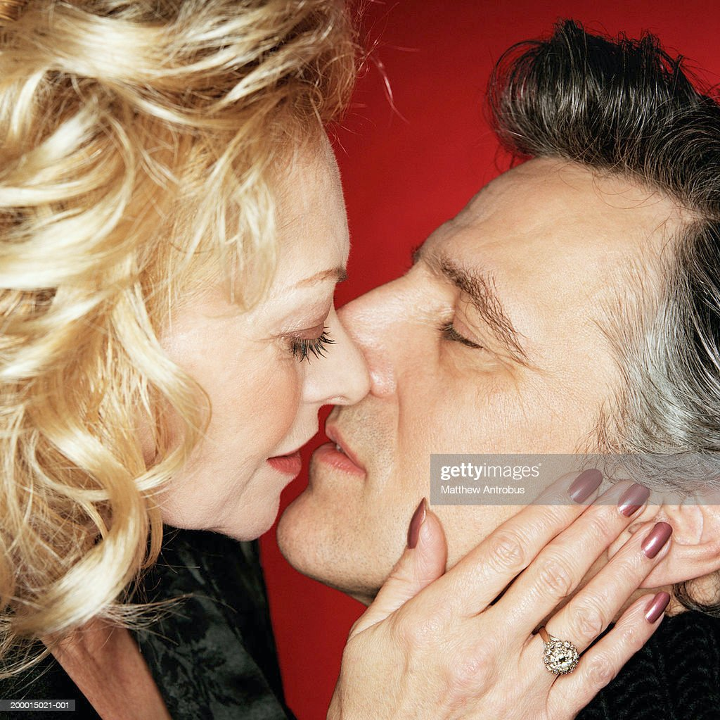 mature couple kissing closeup stock photo | getty images