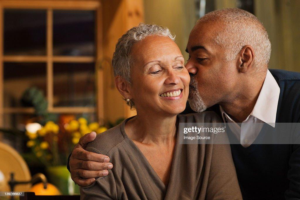 Mature couple kissing : Stock Photo