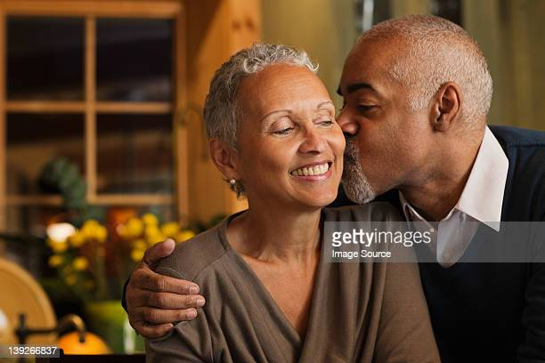 mature couple kissing - falling in love stock pictures, royalty-free photos & images