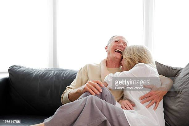 Mature couple laughing and cuddling