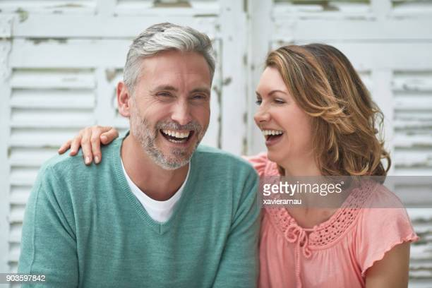 Mature couple laughing outdoors