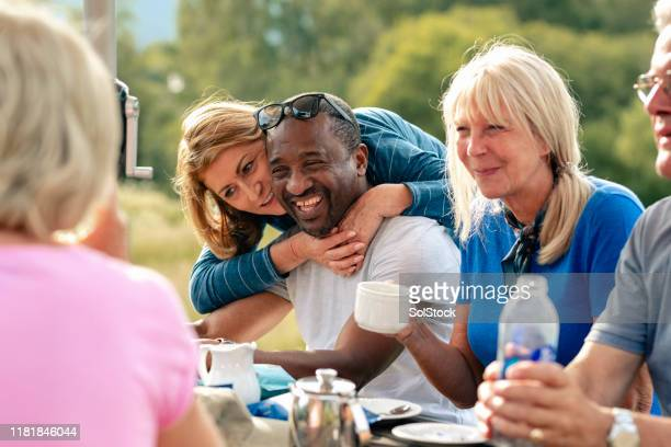 mature couple leaning on each other - english lake district stock pictures, royalty-free photos & images