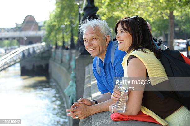 Mature Couple Look out across River Thames in London
