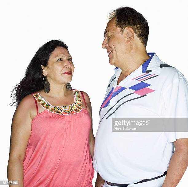 Mature couple looking adoringly at each other