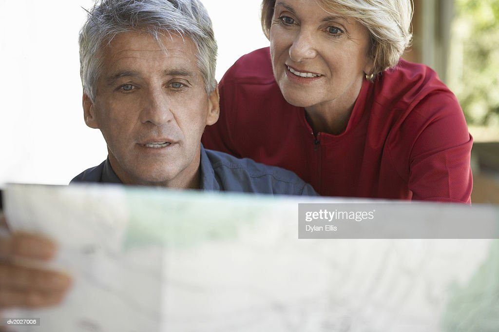 Mature Couple Looking at a Map : Stock Photo