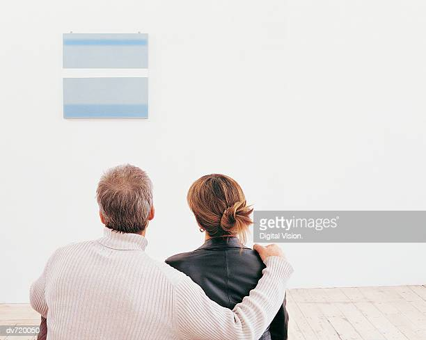 Mature Couple Looking at a Painting